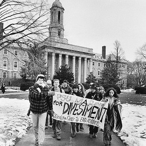 Like these Penn State students in 1987, people enrolled at many U.S. colleges asked their schools to sell stocks in companies that still did business in South Africa. (AP Photo/Craig Houtz)