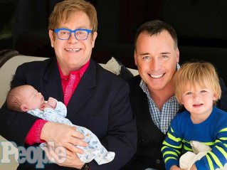 Elton, hubby, and sons.